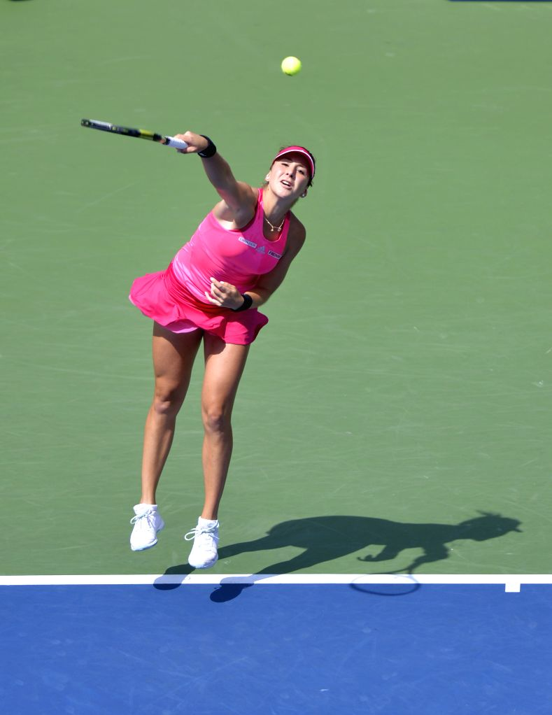 Belinda Bencic of Switzerland returns a shot against Peng Shuai of China during women's singles quarterfinal match at the 2014 U.S. Open in New York, the United ...