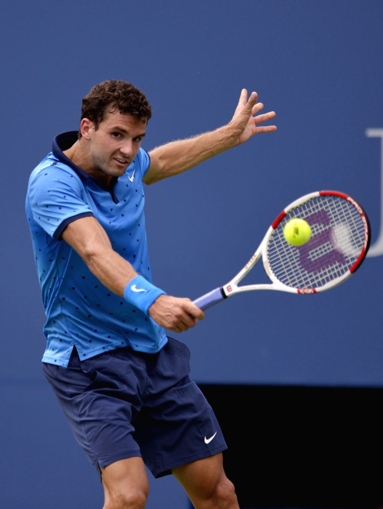 Grigor Dimitrov of Bulgaria returns a shot to Gael Monfils of France during the fourth round match of men's singles at the 2014 U.S. Open in New York, the United ..