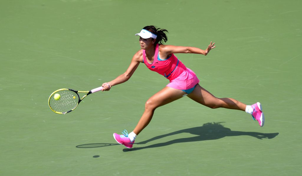 Peng Shuai of China returns a shot during the women's singles quarterfinal match against Belinda Bencic of Switzerland at the 2014 U.S. Open in New York, the ...