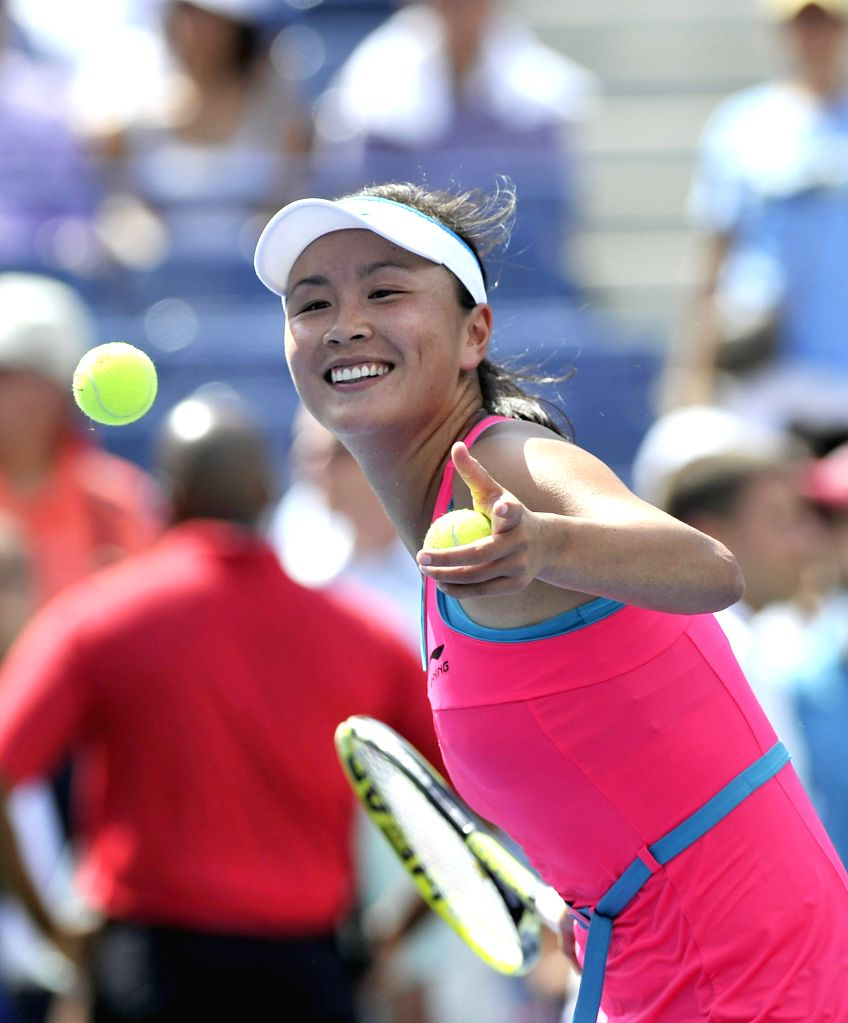 Peng Shuai of China entertains the spectators after winning the women's singles quarterfinal match against Belinda Bencic of Switzerland at the 2014 U.S. Open in ..