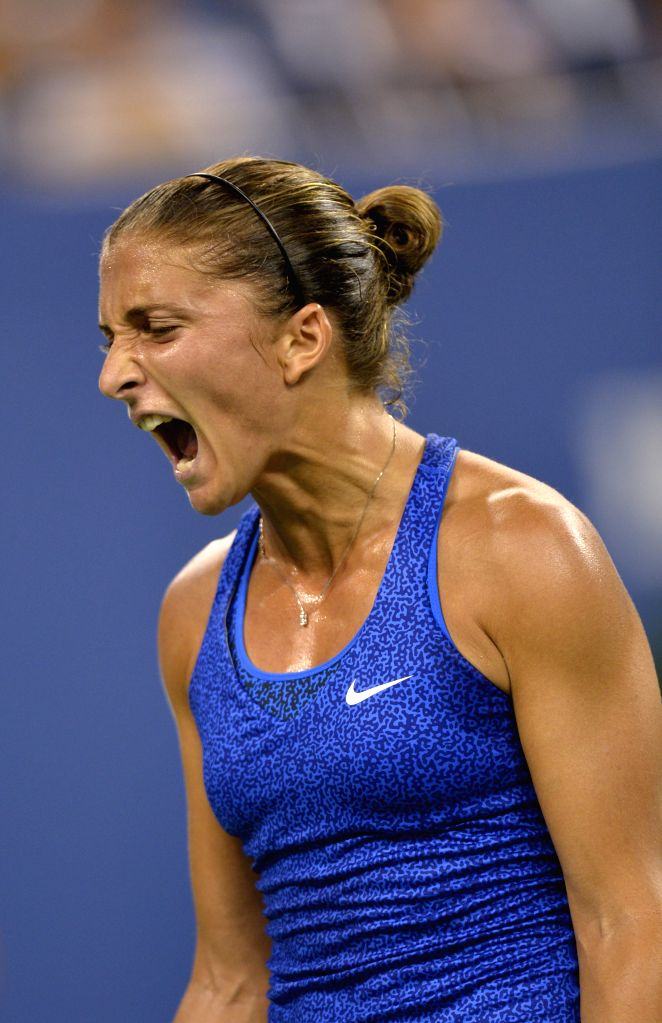Sara Errani of Italy reacts during the women's singles quarterfinal match against Caroline Wozniacki of Denmark at the 2014 U.S. Open in New York, the United ...