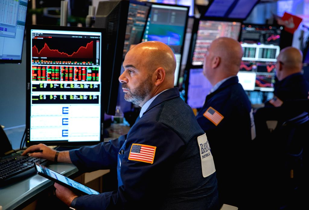 NEW YORK, Sept. 3, 2019 - Traders work at the New York Stock Exchange in New York, the United States, on Sept. 3, 2019. U.S. stocks closed lower on Tuesday. The Dow Jones Industrial Average fell ...
