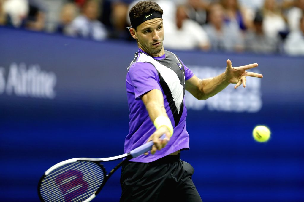 NEW YORK, Sept. 4, 2019 - Grigor Dimitrov hits a return during the men's singles quarter final match between Roger Federer of Switzerland and Grigor Dimitrov of Bulgaria at the 2019 US Open in New ...