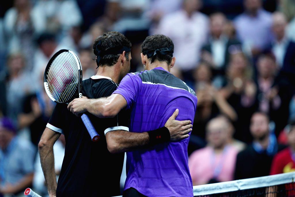 NEW YORK, Sept. 4, 2019 - Roger Federer(L) of Switzerland hugs with Grigor Dimitrov of Bulgaria after the men's singles quarter final match between Roger Federer of Switzerland and Grigor Dimitrov of ...