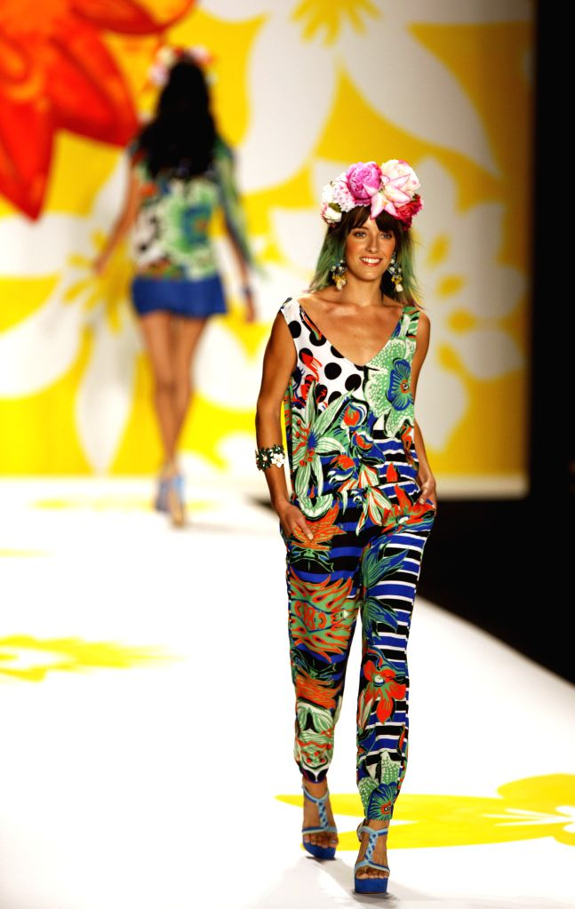 A model presents a creation from the Spring/Summer 2015 Desigual collection during the New York Fashion Week in New York, the United States, Sept. 4, 2014. ...