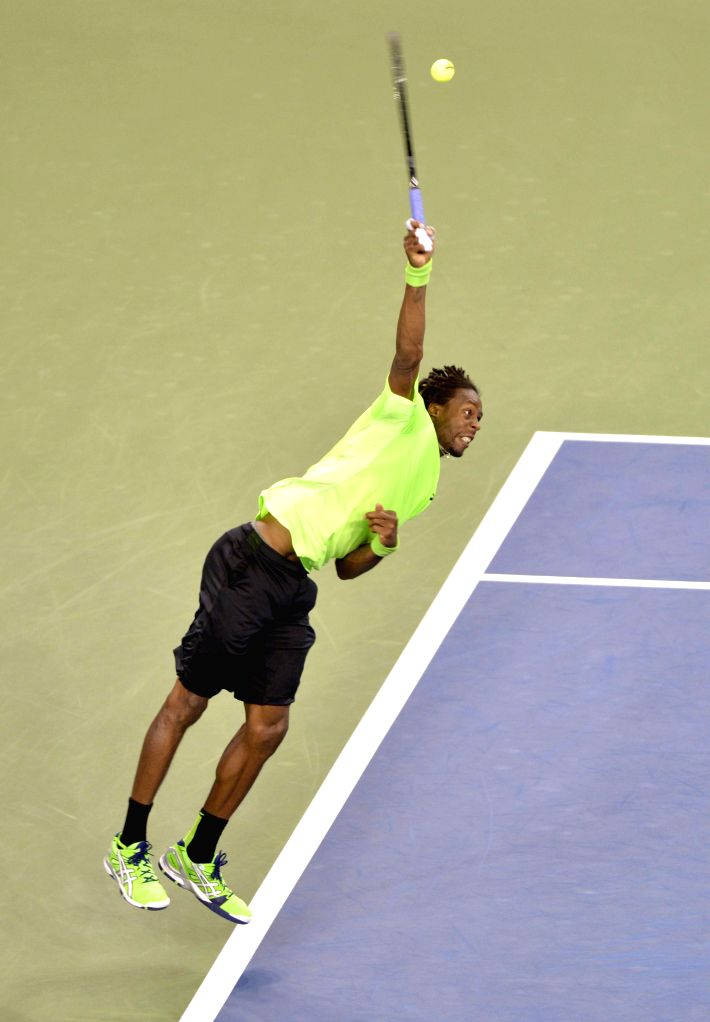 Gael Monfils of France serves the ball during the men's singles quarter-final against Roger Federer of Switzerland at the 2014 U.S. Open in New York, the United ...