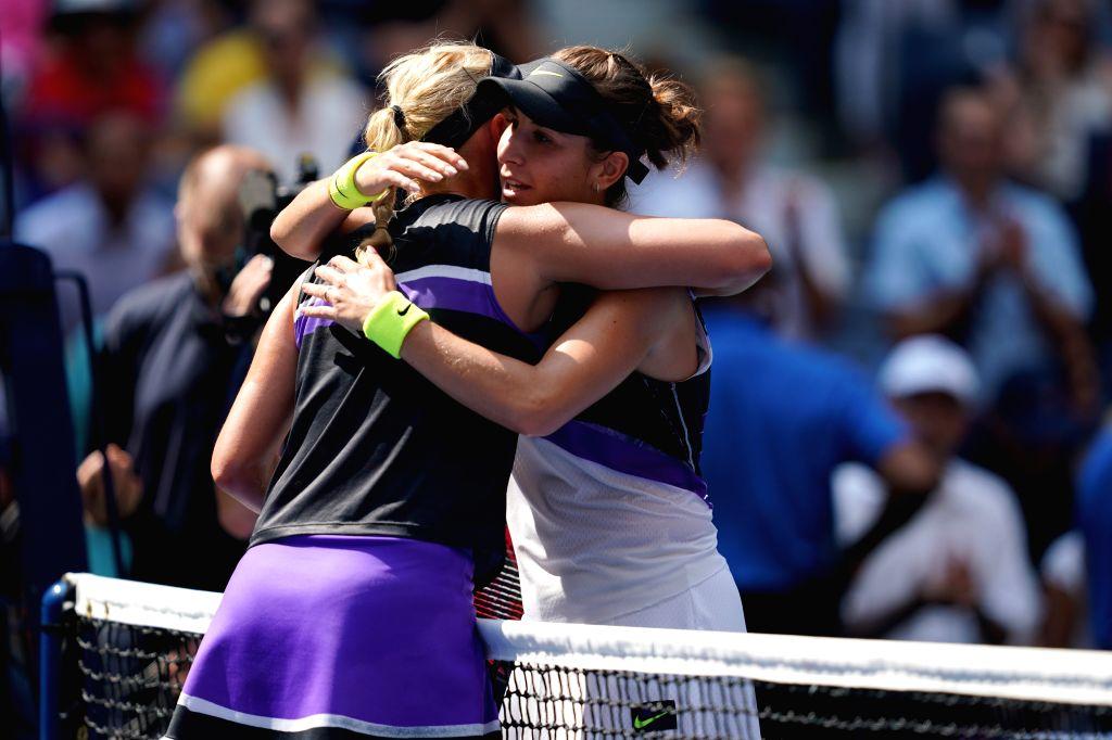 NEW YORK, Sept. 5, 2019 - Belinda Bencic(R)  hugs Donna Vekic after the women's singles quarterfinal match between Belinda Bencic of Switzerland and Donna Vekic of Croatia at the 2019 US Open in New ...