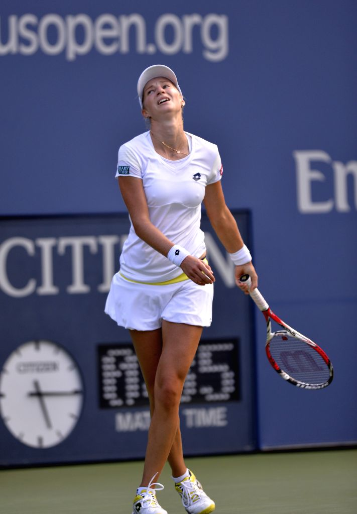 Ekaterina Makarova of Russia reacts during the women's singles semifinal match against Serena Williams of the United States at the 2014 U.S. Open in New York, the .