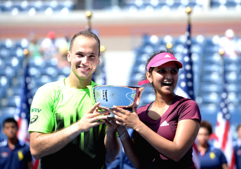 Sania Mirza of India (R) and Bruo Soares of Brazil hold the trophy during the awarding ceremony after their Mixed Doubles Final match against Abigail Spears of the - Sania Mirza