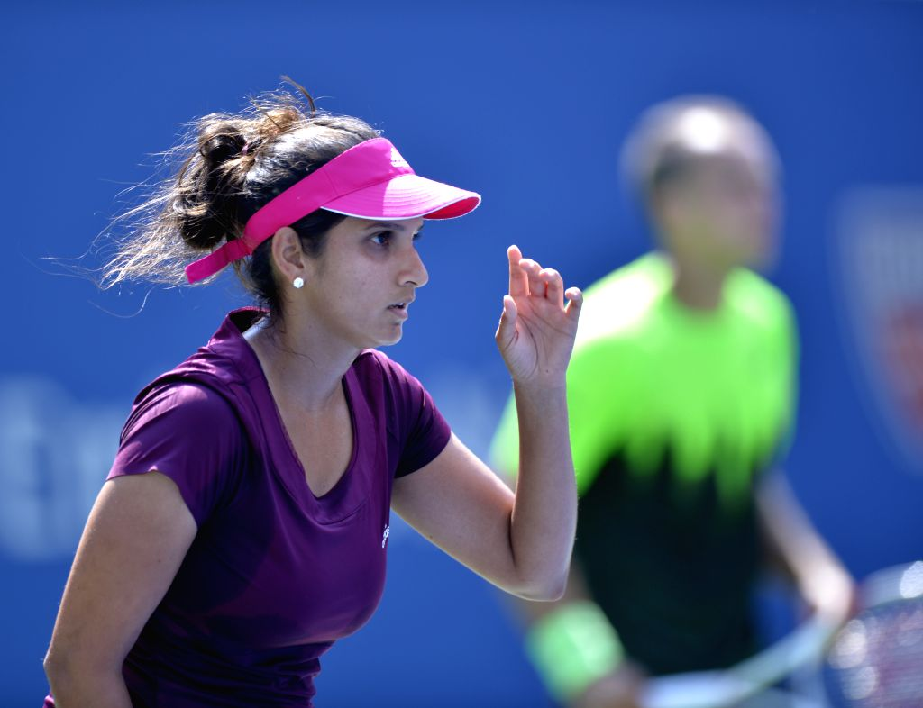Sania Mirza of India (L) and Bruo Soares of Brazil compete during their Mixed Doubles Final match against Abigail Spears of the United States and Santiago Gonzalez - Sania Mirza