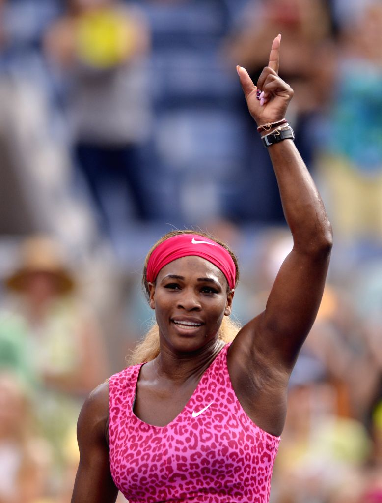 Serena Williams of the United States celebrates after defeating Ekaterina Makarova of Russia during their women's singles semifinal match at the 2014 U.S. Open in .