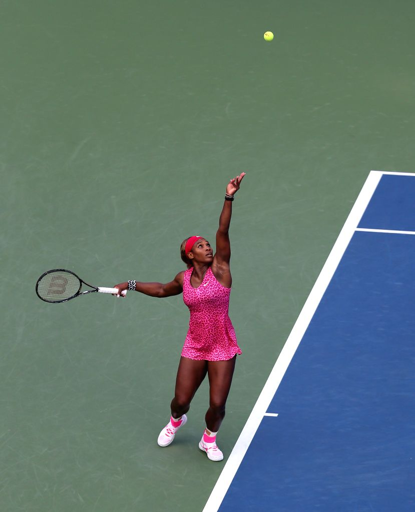 Serena Williams of the United States serves during the women's singles semifinal match against Ekaterina Makarova of Russia at the 2014 U.S. Open in New York, the .