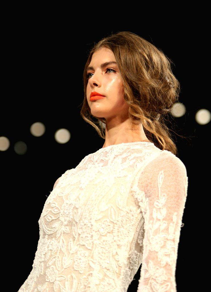 A model presents a creation of the Spring/Summer 2015 LUIS ANTONIO collection during the New York Fashion Week in New York, the United States, Sept. 6, 2014.  ...