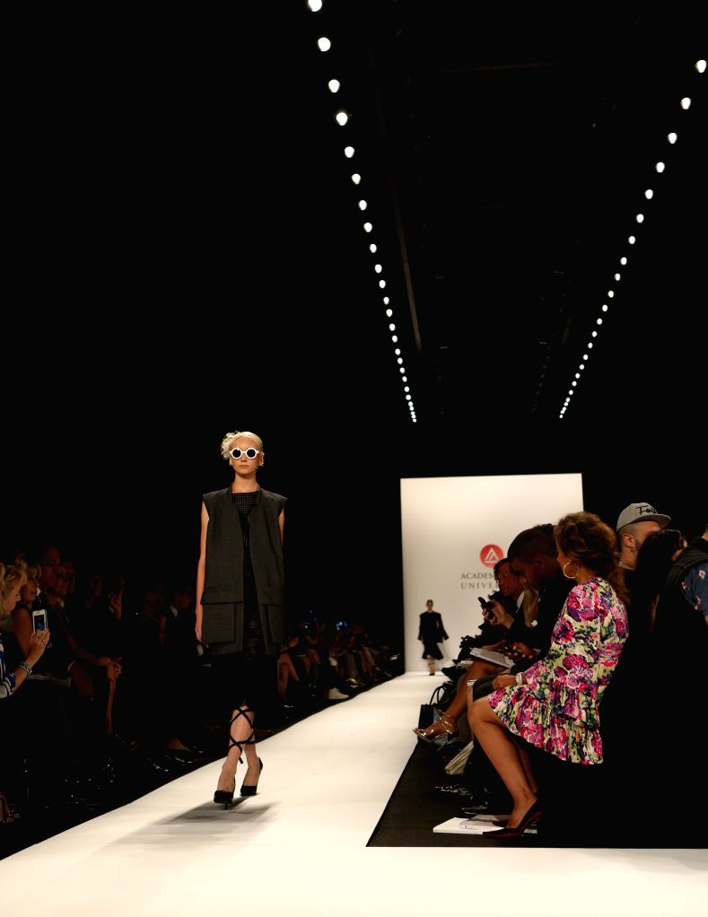 A model presents a creation by designers from Academy of Art University during the 2015 New York Fashion Week in New York, the United States, on Sept. 6, 2014. ...