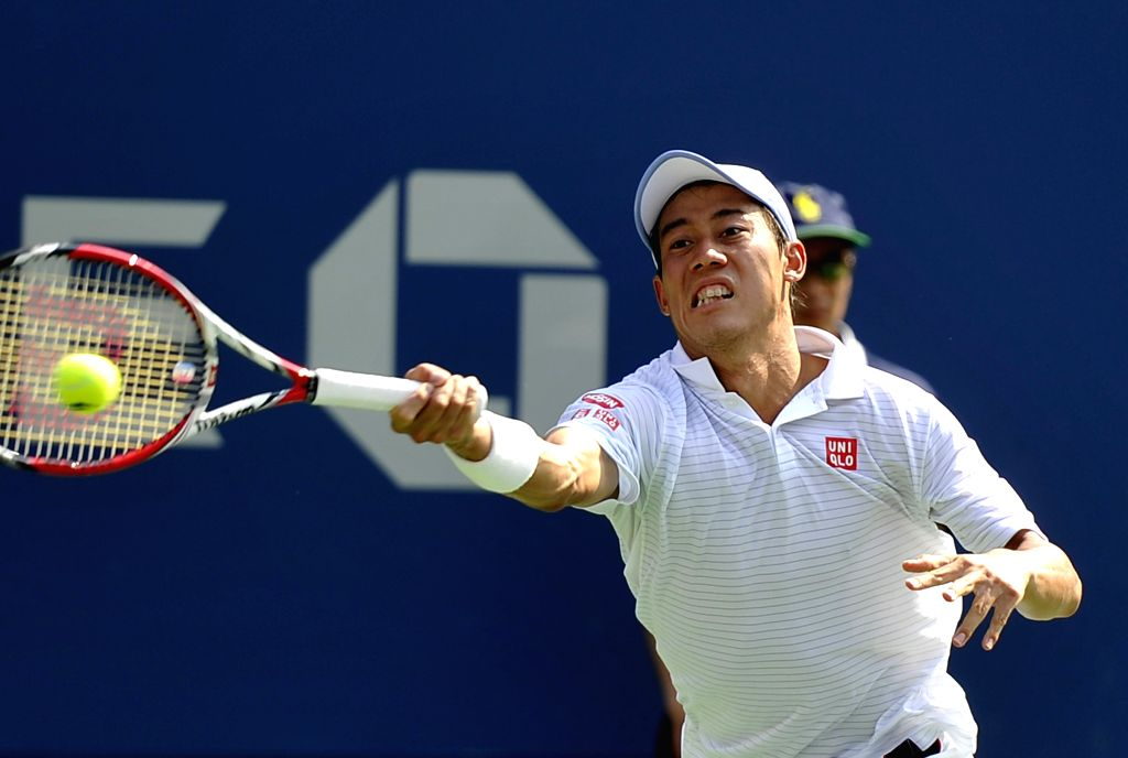 Kei Nishikori of Japan returns a shot to Novak Djokovic of Serbia during their men's singles semifinal match at the 2014 U.S. Open in New York, the United States, .