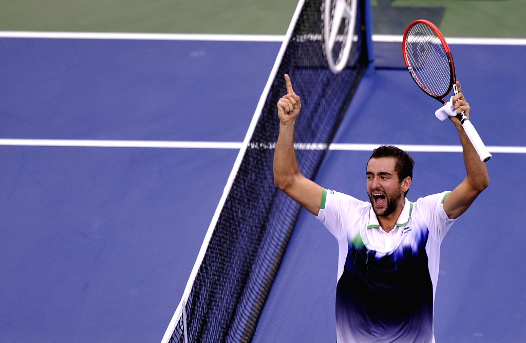 Marin Cilic of Croatia celebrates after the men's singles semifinal match against Roger Federer of Switzerland at the 2014 U.S. Open in New York, the United ...