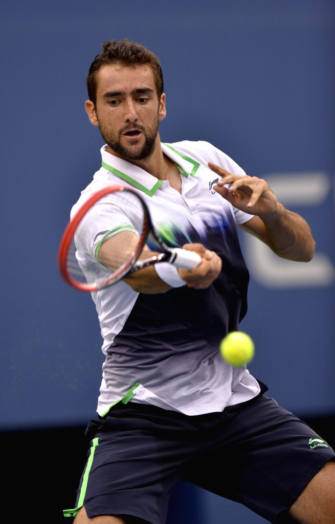 Marin Cilic of Croatia returns a shot during the men's singles semifinal match against Roger Federer of Switzerland at the 2014 U.S. Open in New York, the United ..