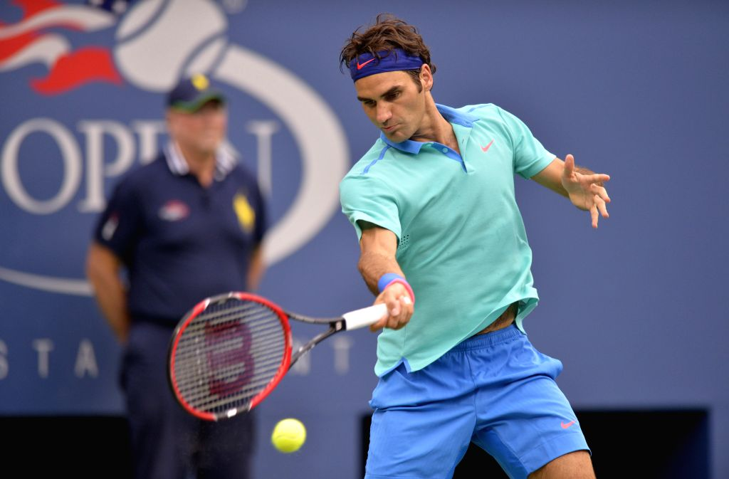 Roger Federer of Switzerland returns a shot during the men's singles semifinal match against Marin Cilic of Croatia at the 2014 U.S. Open in New York, the United ..