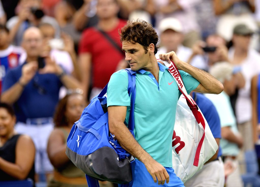 Roger Federer of Switzerland leaves the court after the men's singles semifinal match against Marin Cilic of Croatia at the 2014 U.S. Open in New York, the United .