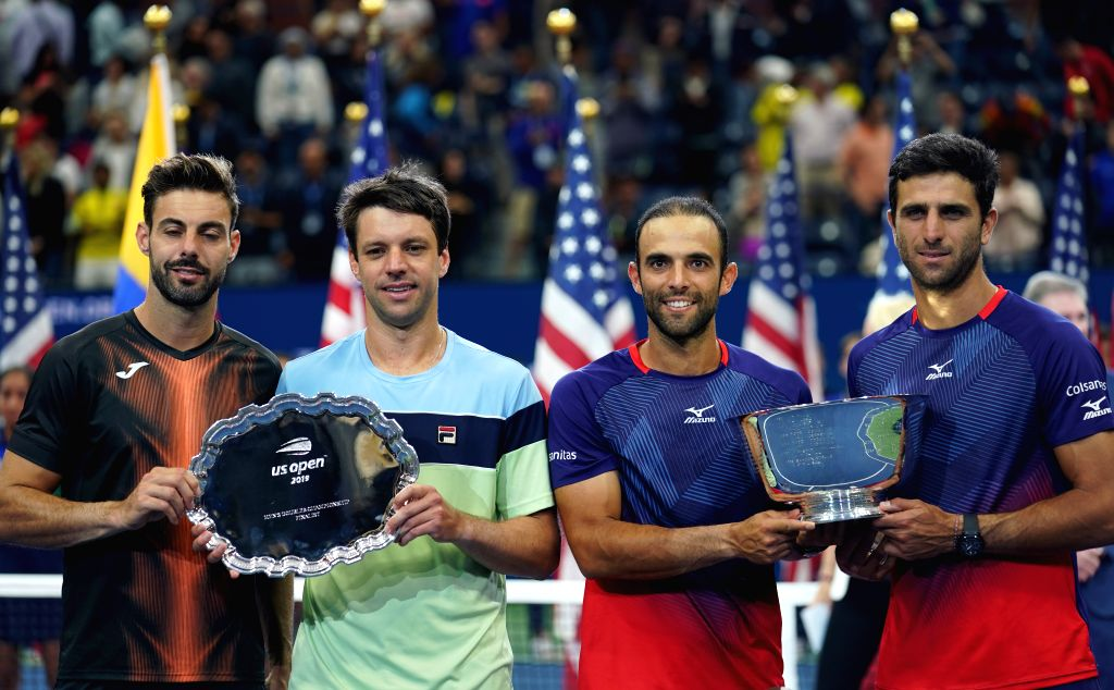 NEW YORK, Sept. 7, 2019 - Juan Sebastian Cabal (2nd R)/Robert Farah (1st R) of Colombia and Marcel Granollers (1st L) of Spain/Horacio Zeballos of Argentina pose during the awarding ceremony after ...
