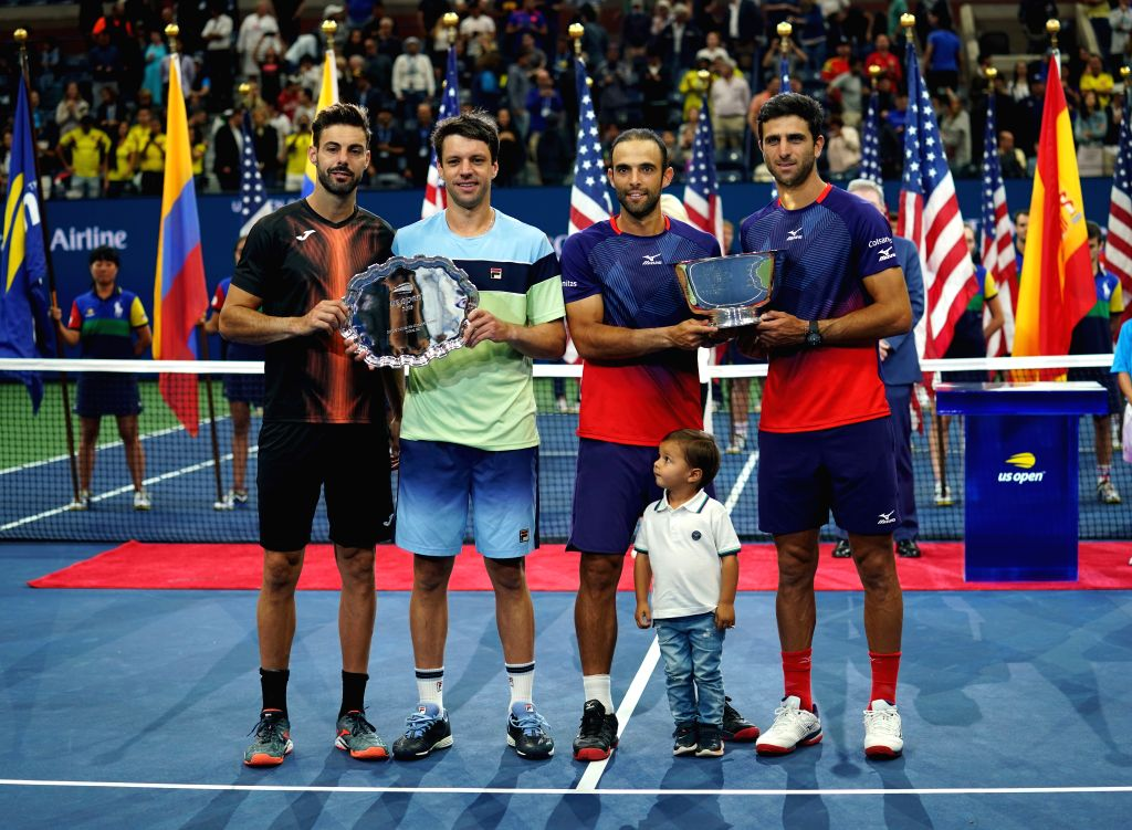 NEW YORK, Sept. 7, 2019 - Juan Sebastian Cabal (3rd R)/Robert Farah (1st R) of Colombia and Marcel Granollers (1st L) of Spain/Horacio Zeballos (2nd L) of Argentina pose with Cabal's son Jacobo ...