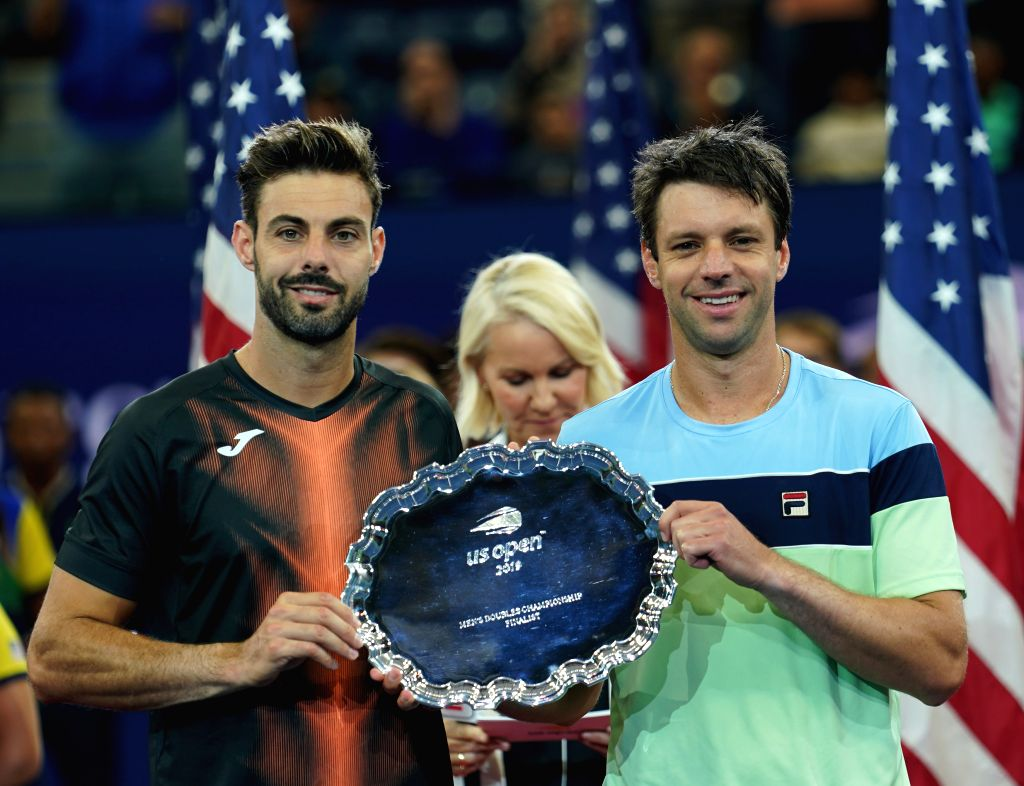 NEW YORK, Sept. 7, 2019 - Marcel Granollers (L) of Spain/Horacio Zeballos of Argentina pose during the awarding ceremony after the men's doubles final match between Juan Sebastian Cabal/Robert Farah ...