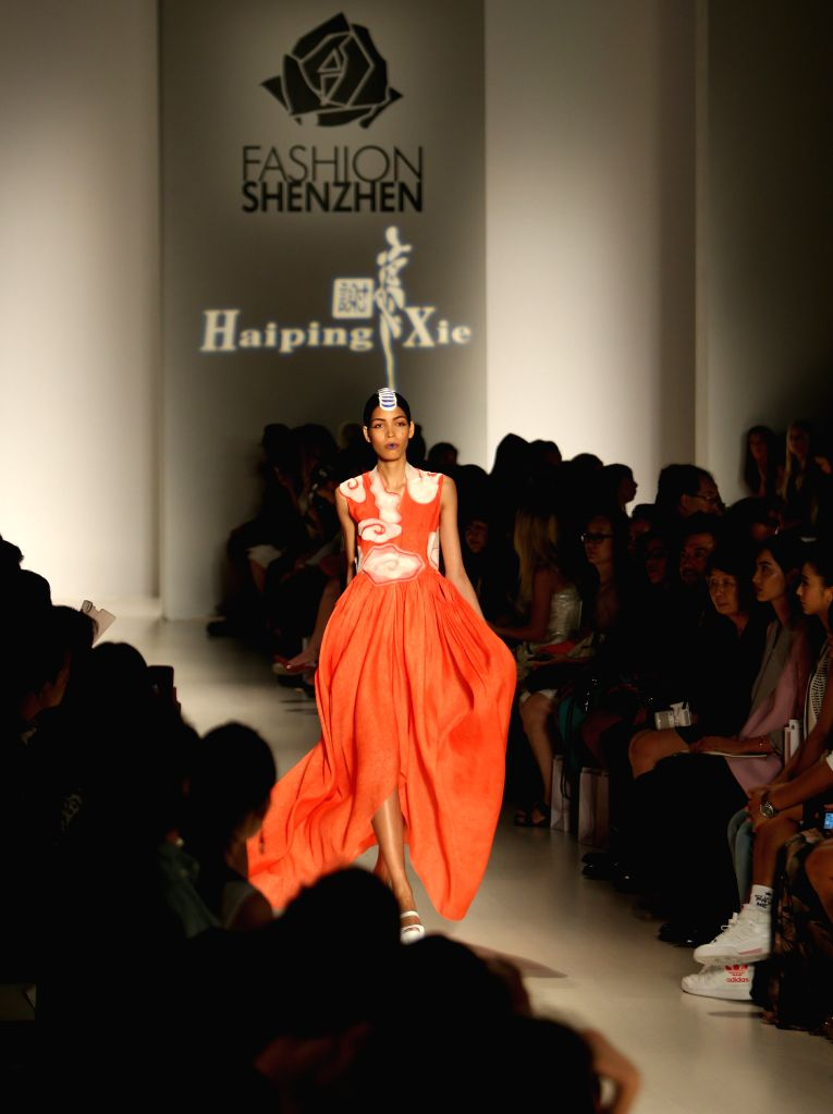 A model presents a creation of the 2015 FASHION SHENZHEN collection during the New York Fashion Week in New York, the United States, Sept. 7, 2014.  (Xinhua/Qin ...