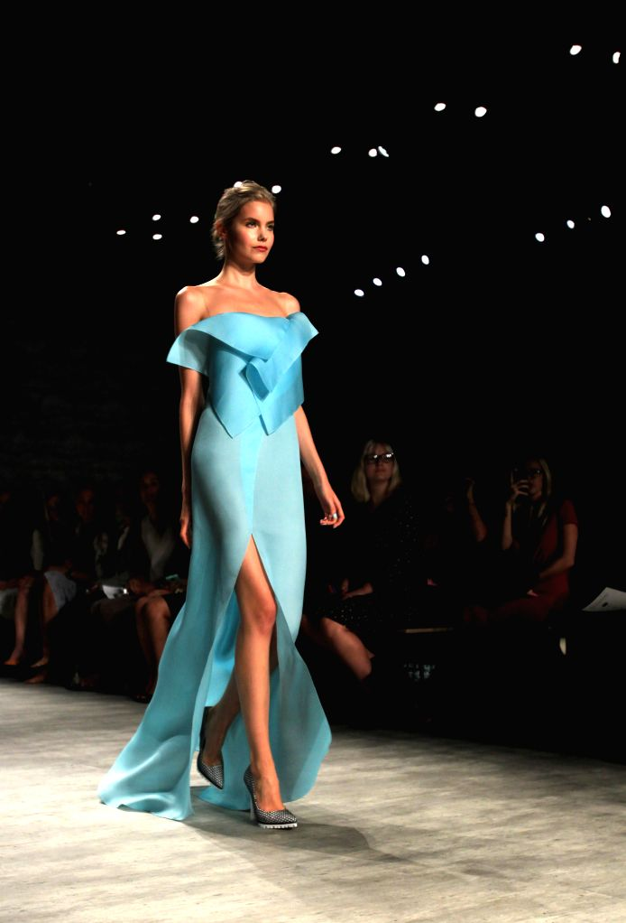A Model presents a creation of the Spring/Summer 2015 ANGEL SANCHEZ collection during the New York Fashion Week in New York, the United States, Sept. 8, 2014.