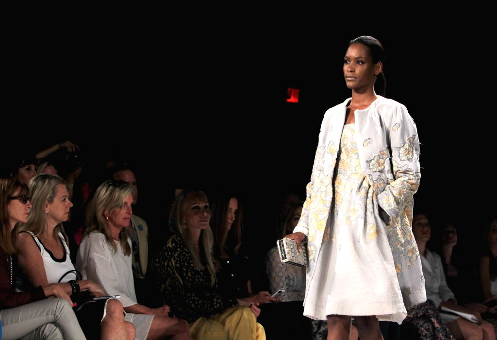 A model presents a creation of the Spring/Summer 2015 DENNIS BASSO collection during the New York Fashion Week in New York, the United States, Sept. 8, 2014.
