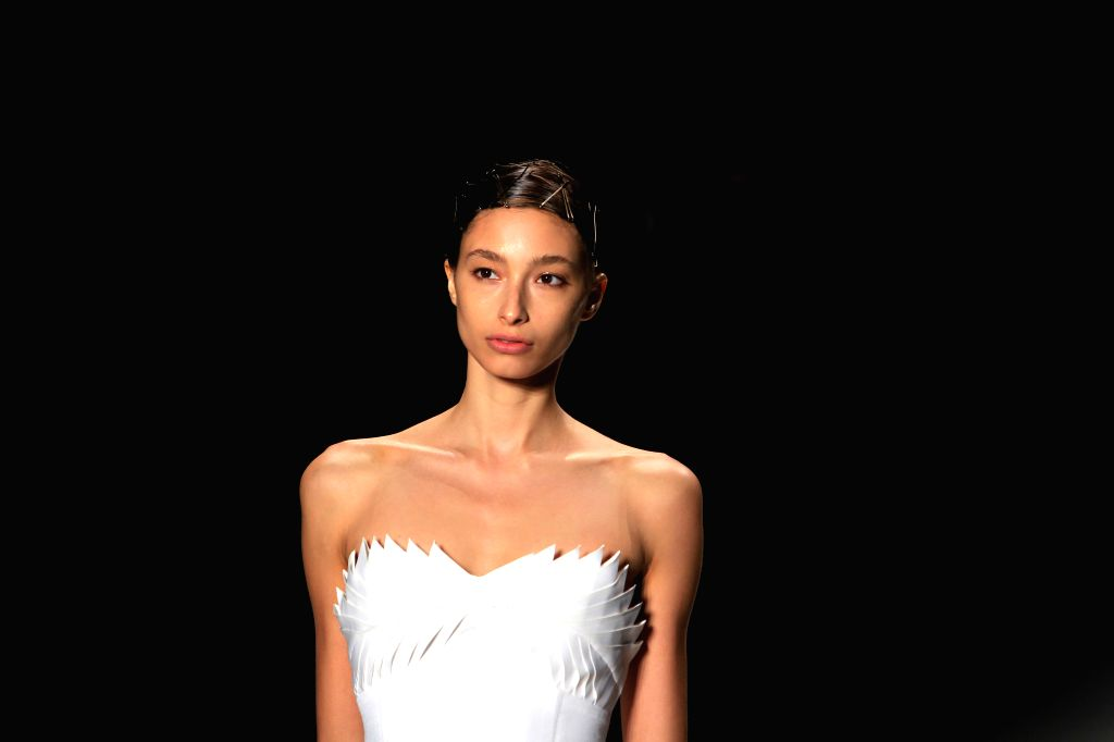 A model presents a creation of the Spring 2015 TAORAY WANG collection during the New York Fashion Week in New York, the United States, Sept. 8, 2014.