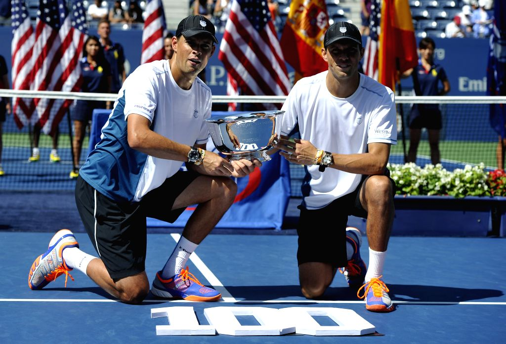 Bob Bryan and Mike Bryan of the United States pose during the awarding ceremony after the men's doubles final match against Marcel Granollers and Marc Lopez of ...