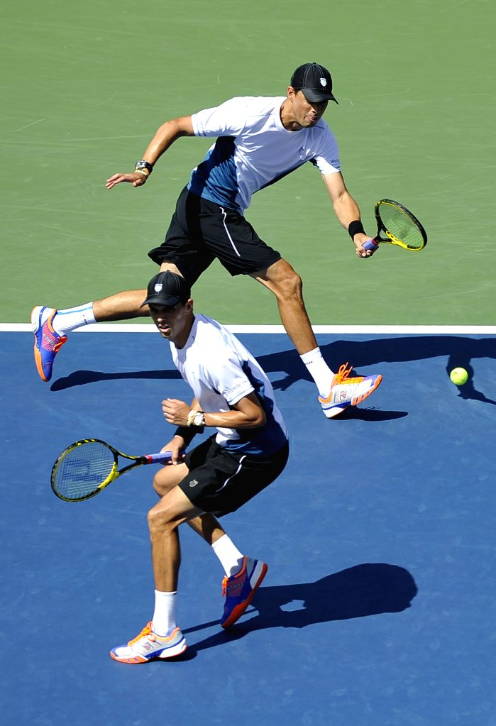 Bob Bryan and Mike Bryan of the United States compete during the men's doubles final match against Marcel Granollers and Marc Lopez of Spain at the 2014 U.S. Open .