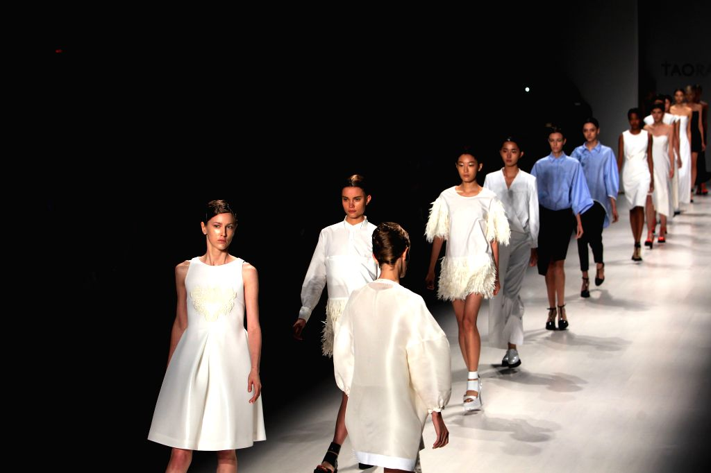 Models present creations of the Spring 2015 TAORAY WANG collection during the New York Fashion Week in New York, the United States, Sept. 8, 2014.