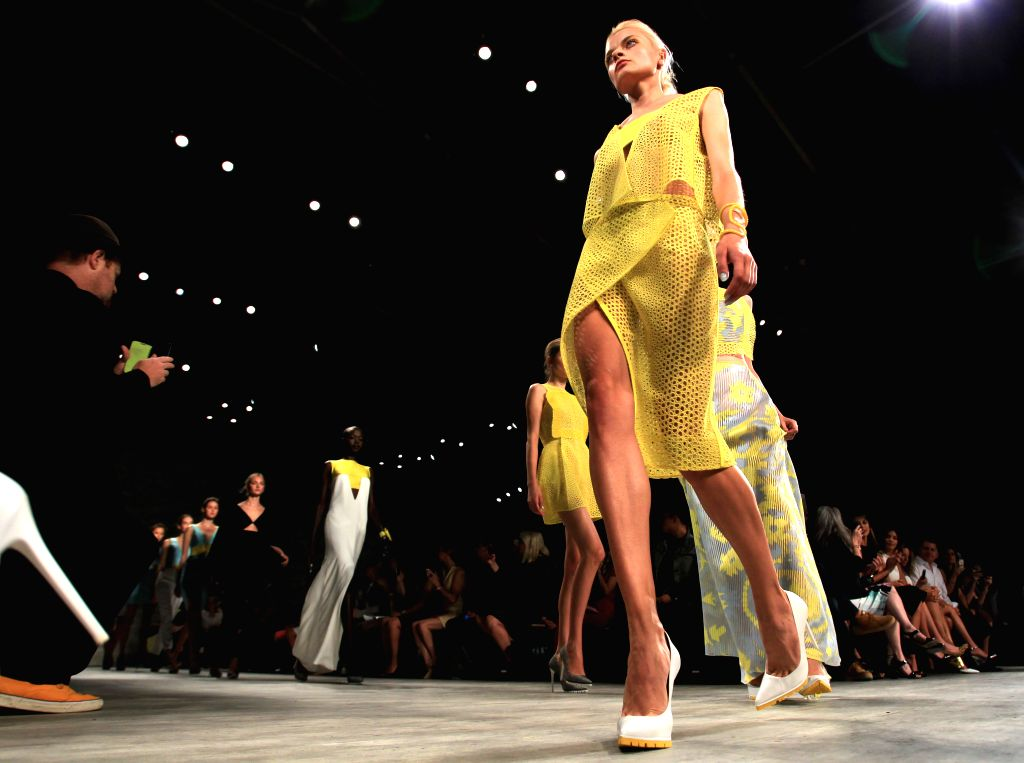 Models present creations of the Spring/Summer 2015 ANGEL SANCHEZ collection during the New York Fashion Week in New York, the United States, Sept. 8, 2014.
