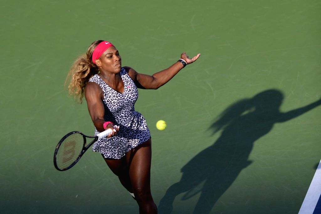 Serena Williams of the United States returns a shot against Caroline Wozniacki of Denmark during their women's singles final match at the 2014 U.S. Open in New ...