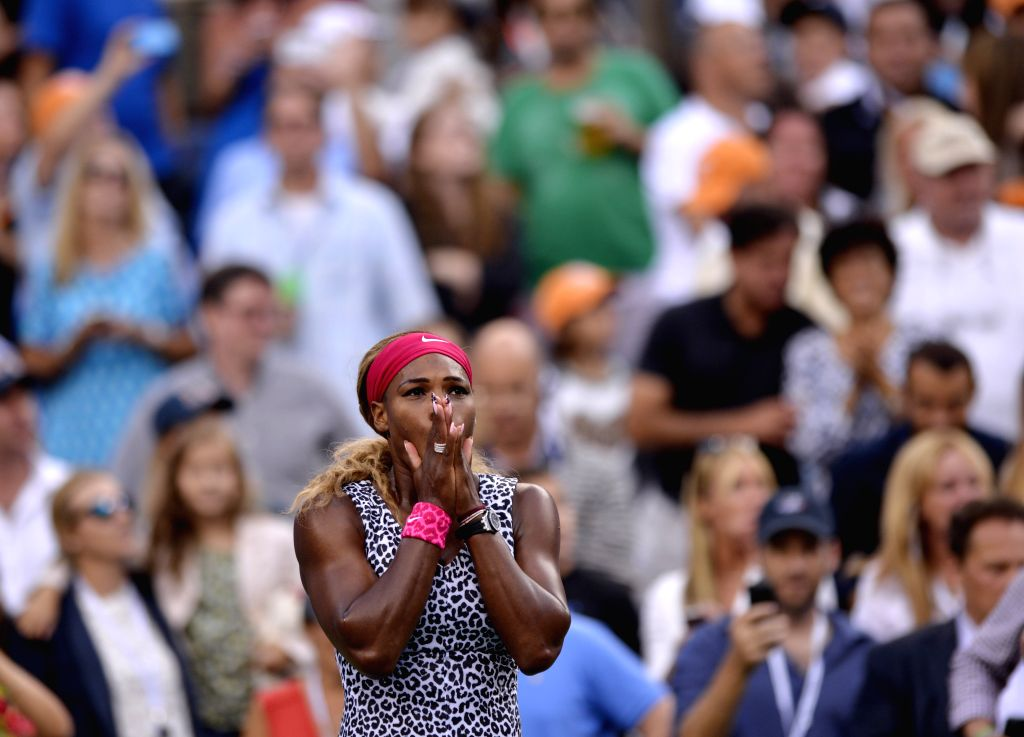 Serena Williams of the United States celebrates during the awarding ceremony after the women's singles final match against Caroline Wozniacki of Denmark at the ...