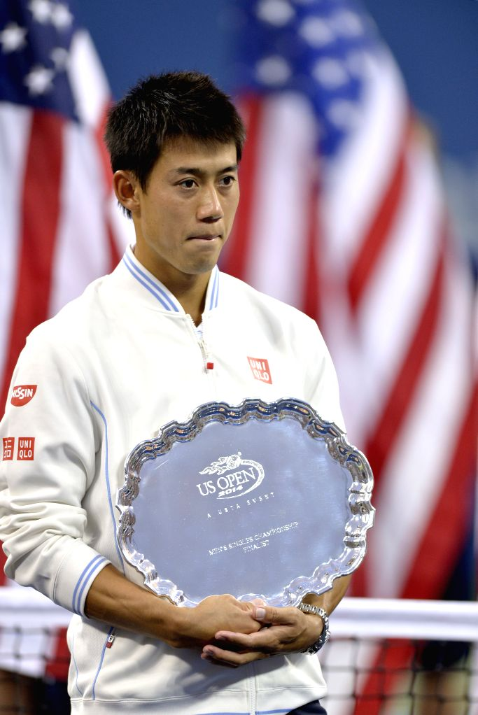 Kei Nishikori of Japan reacts during the awarding ceremony for men's singles at the 2014 U.S. Open in New York, the United States, Sept. 8, 2014. Kei Nishikori was