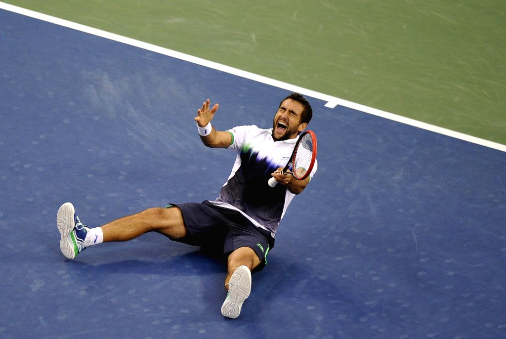 Marin Cilic of Croatia celebrates after winning the men's singles final match against Kei Nishikori of Japan at the 2014 U.S. Open in New York, the United States, .