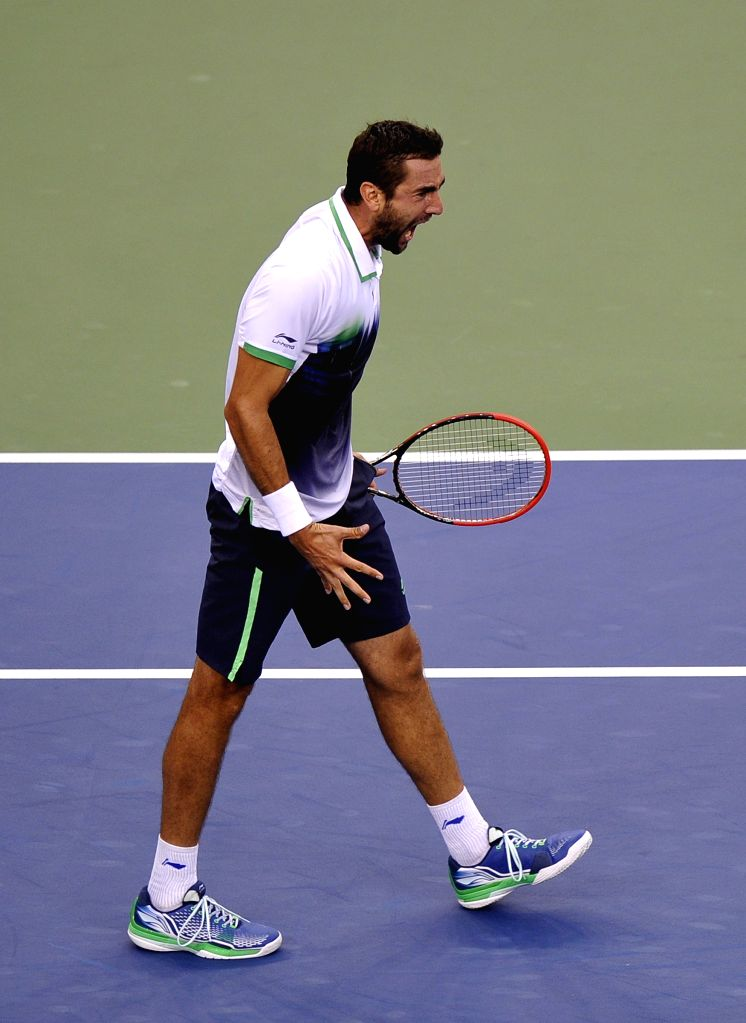 Marin Cilic of Croatia celebrates during the men's singles final match against Kei Nishikori of Japan at the 2014 U.S. Open in New York, the United States, Sept. ..