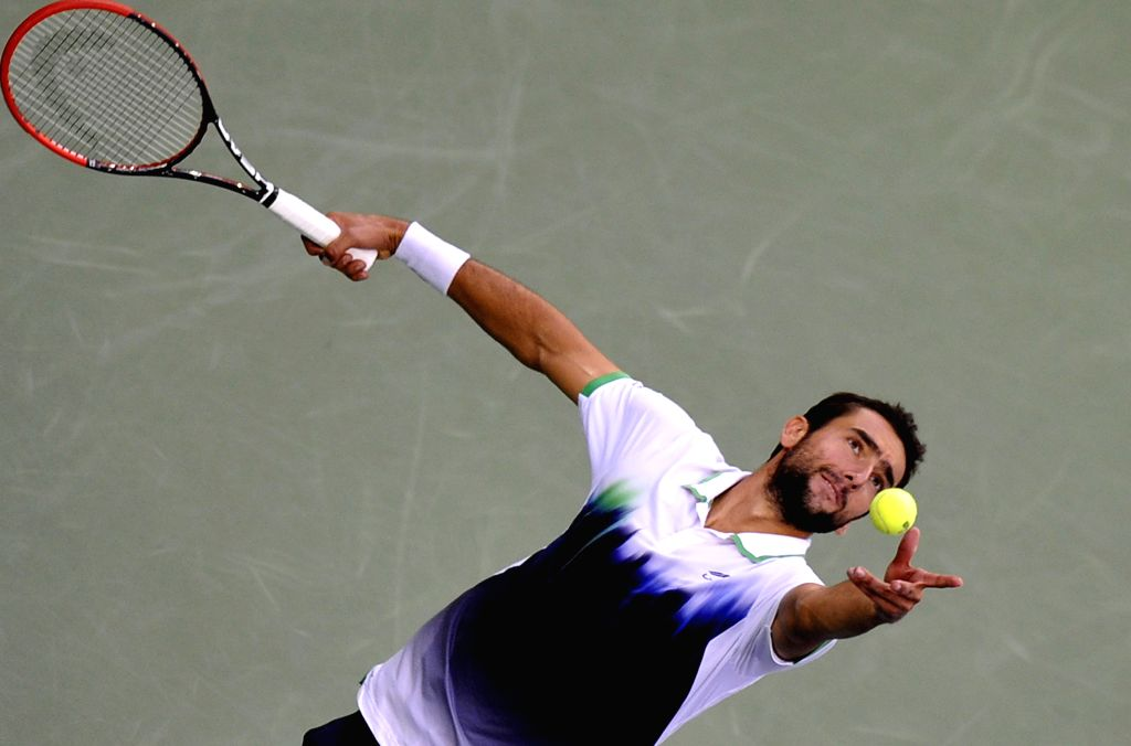 Marin Cilic of Croatia serves to Kei Nishikori of Japan during the men's singles final match at the 2014 U.S. Open in New York, the United States, Sept. 8, 2014. ..
