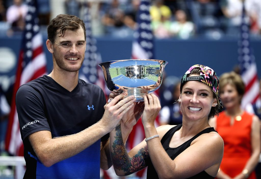 NEW YORK, Sept. 9, 2018 - Bethanie Mattek-Sands (R) of the United States and Jamie Murray of Britain hold up the trophy during the awarding ceremony after winning the mixed doubles final match ...