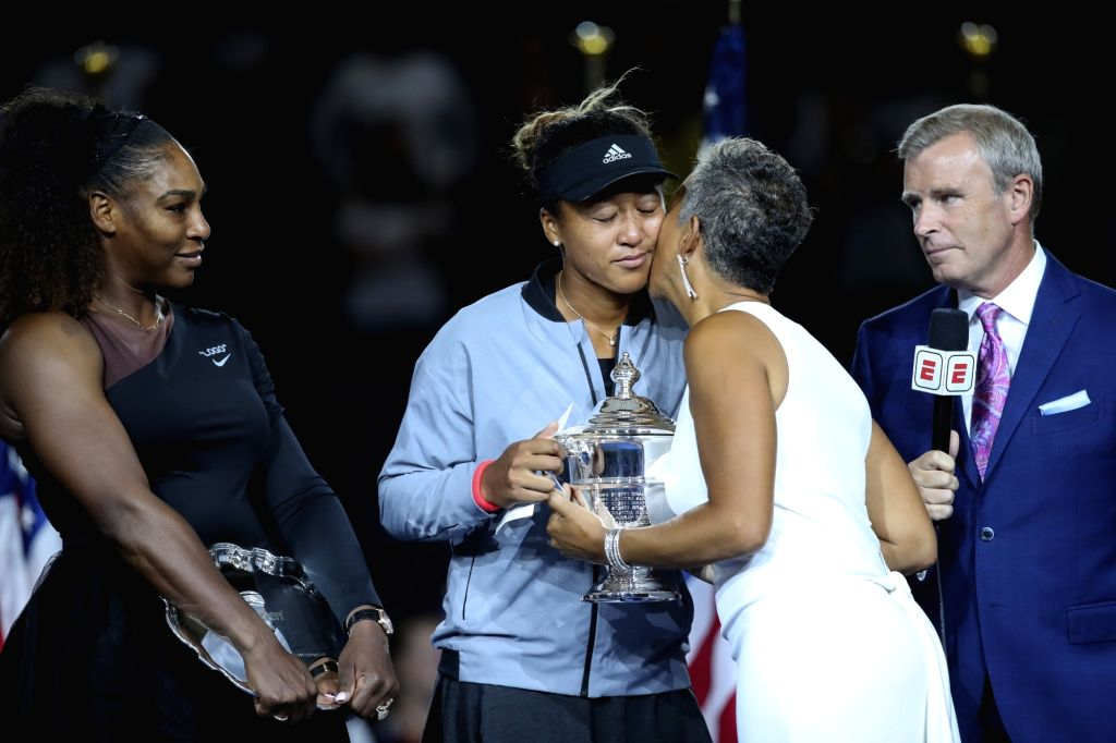 NEW YORK, Sept. 9, 2018 - Naomi Osaka (2nd L) of Japan receives the trophy during the awarding ceremony after winning the women's singles final match against Serena Williams (1st L) of the United ...