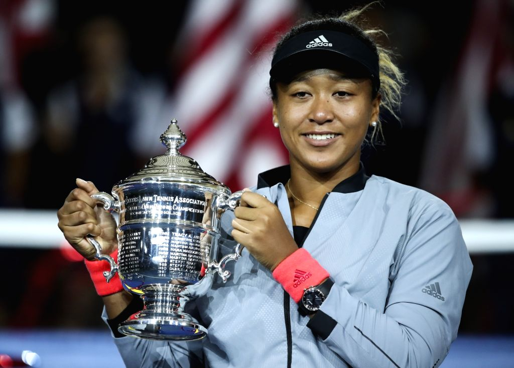 NEW YORK, Sept. 9, 2018 - Naomi Osaka of Japan holds up the trophy during the awarding ceremony after winning the women's singles final match against Serena Williams of the United States at the 2018 ...