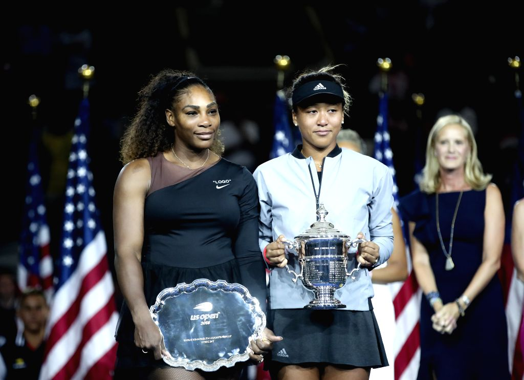 NEW YORK, Sept. 9, 2018 - Serena Williams (L) of the United States and Naomi Osaka of Japan pose for a photo during the awarding ceremony after the women's singles final match at the 2018 US Open ...
