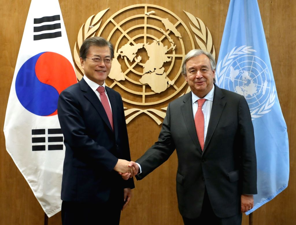New York: South Korean President Moon Jae-in (L) meets with U.N. Secretary-General Antonio Guterres at the U.N. headquarters in New York on Sept. 18, 2017. Moon's aides said the president expressed ...