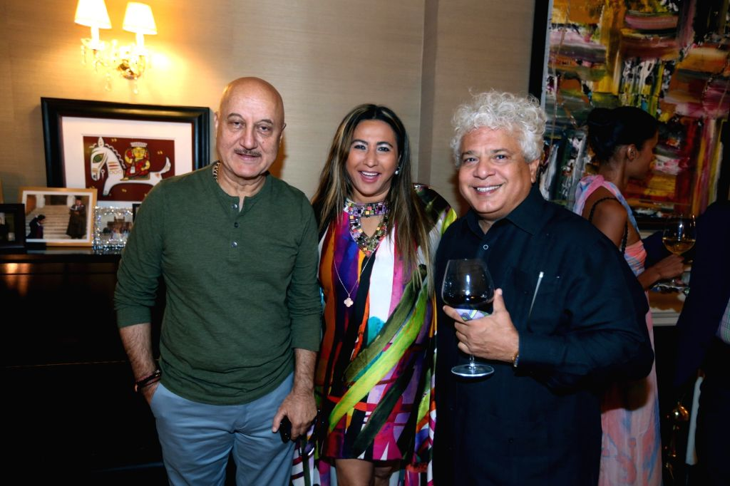 New York: The Giving Back Foundation Founder and CEO Meera Gandhi with actor Anupam Kher and author Suhel Seth during a reception organised at her residence, in New York on Sept 3, 2018. - Anupam Kher, Meera Gandhi and Suhel Seth