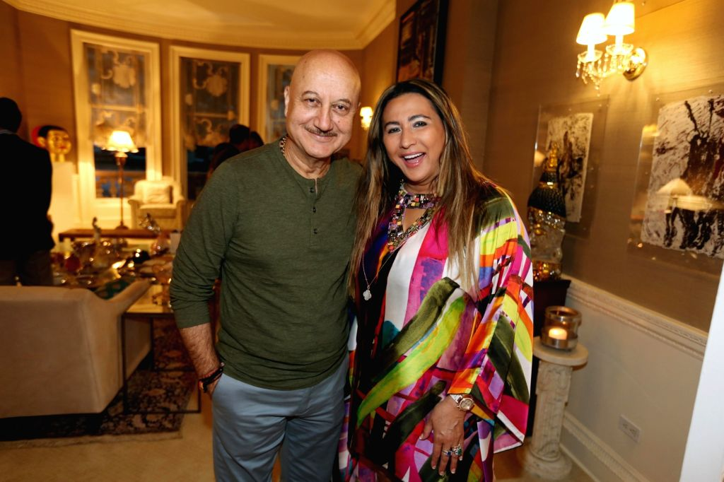 New York: The Giving Back Foundation Founder and CEO Meera Gandhi with actor Anupam Kher during a reception organised at her residence, in New York on Sept 3, 2018. - Anupam Kher and Meera Gandhi