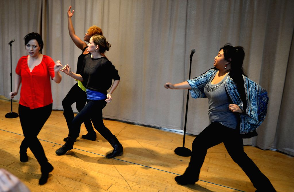 New York (U.S): Actresses perform during a open rehearsal of Disenchanted in New York, the United States, Nov. 13, 2014. The new musical comedy Disenchanted written by Dennis T. Giacino, will be ...