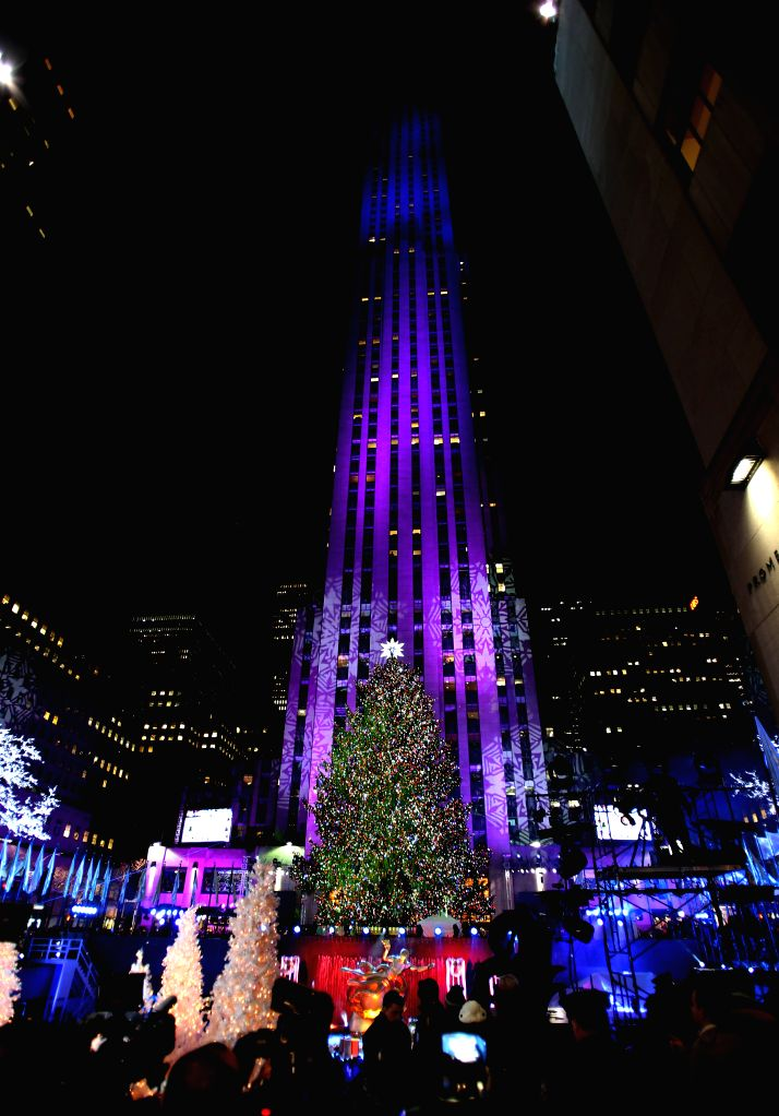 New York (U.S.): Photo taken on Dec. 3, 2014 shows the Christmas tree with all the lights lit up during the 82nd Christmas Tree Lighting Ceremony in Rockefeller Center in New York, the United States.