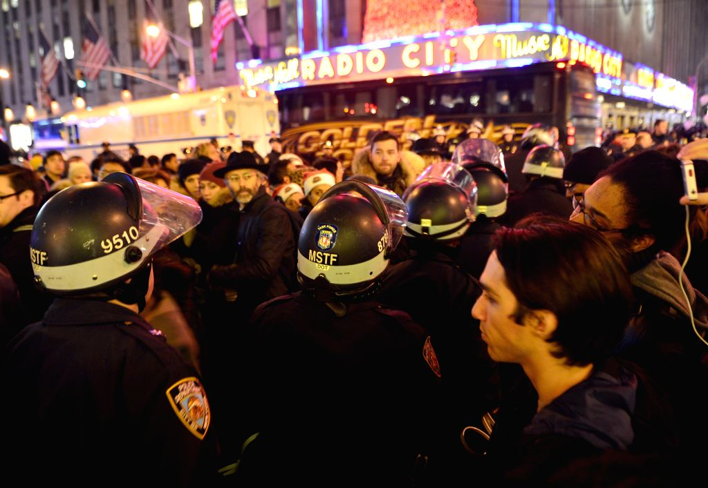 New York (U.S.): Protesters rally at midtown Manhattan in New York, the United States, on Dec. 3, 2014, after a grand jury voted not to indict a white police officer in the chokehold death of a black